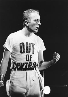 "Another classic from The Clash's Joe Strummer, wearing this ""Out Of Control"" t-shirt at a gig in London."