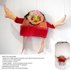 """Pearl"" the marionette - Made from made recycled materials, hand dyed and permanent inks - Original, one of a kind puppet - Full arm stretch - 51cms - Puppet height - 31cms (including strings 76cms) - Has button hole style hook for hanging Created by artist Fern Smith Sale price $120 (does not include postage)"