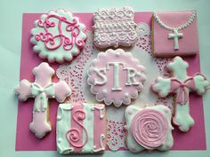 Baby girls baptism light pink sugar cookies. Pearls, crosses, bows on the cross, monograms, lace, roses, and polka dots. The sweetest and most feminine thing.