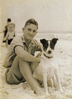 "A dog and his boy, beach in Australia, 1937. Looks like our dog Slick. His expression is the same ""Is that a squirrel?"""