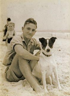 A dog and his boy, beach in Australia, 1937