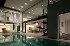 Tel Aviv-based studio Pitsou Kedem Architects has designed the Contemporary Bauhaus on the Carmel project.    This 5,900 square foot two story contemporary home is located in the center of a historic avenue in Haifa's French Carmel neighborhood, Israel.