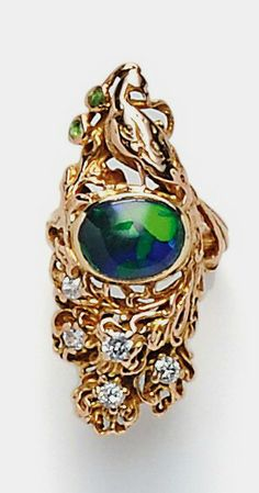 Art Nouveau 14kt Gold and Opal Peacock Ring, Walton & Co., the elaborate peacock set with an oval cabochon opal, the tail with old European-cut diamonds, and demantoid garnet accents, lg. 1 1/4 in., size 3 3/4, signed.
