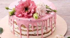 Lovely naked cake with pink icing drizzled with pink flowers