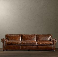 worn leather sofa clean lines broken in relaxed look nail head