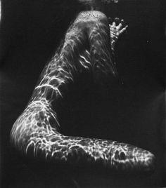 underwater nude... brett weston  http://www.ionok.com/wp-content/uploads/Underwater-Nude-1980-by-Brett-Weston-20x16-Silver-Celatin-Print.jpg