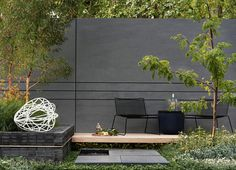 Modern dark garden. Pinned to Garden Design - Walls, Fences & Screens by BASK Landscape Design.