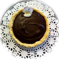Heavenly Dark Chocolate 75% Tart nestled in an Almond Shortcrust bedazzled with an edible candied violet  Alexander's Chocolate Classics, 309 E. Main St. Dayton WA. (509) 240-7531 http://www.alexanders-chocolate-classics.com/