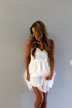 Simple, short and casual wedding dress for the effortless beautiful bride. Features round sheer neckline with sweetheart bodice Bottom