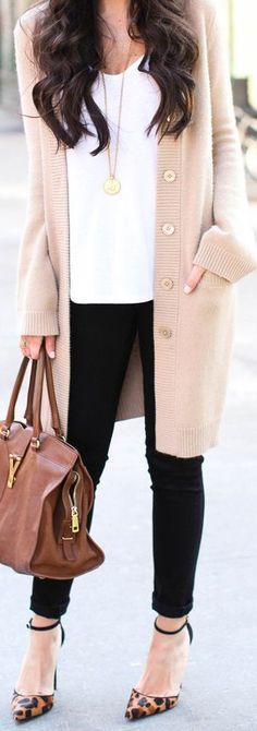 In love with neutral colors - black leggings, white shirt, beige cardigan, pointed high heels, brawn leather handbag, jewellery. Brawn wavy long hairstyle.