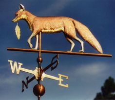 Fox Weather Vane with Feather by West Coast Weather Vanes. This Fox weathervane was completed in 1999 and had optional gilding added to the muzzle, chest, belly, tail tip and feather. Weather Vain, Lightning Rod, Fox Decor, Little Fox, Fox Hunting, Fox Art, Red Fox, Equestrian Style, Shop Signs