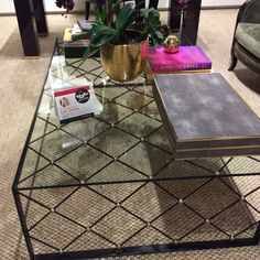 Spotted Aerin's Lauzet Occasional Table at Ej Victor. The scale and attention to detail along with ts refined diamond pattern adds sophisticated drama with black and rubbed brass accents.  Aerin Home Furnishings 118 South Lindsay St.