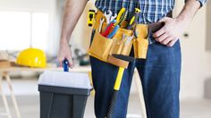 Construction worker holding a toolbox. Part of male construction worker ,