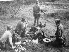 Posed image depicting the basic SAS jungle four-man patrol - Scout, Ptl Commander, Signaller and Medic. The ptl commander will be demolitions trained and along with the lead scout would carry the patrols claymore mines. Note pump action 12-bore shotgun carried.