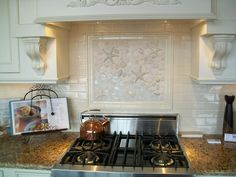 Beautiful shell & star fish back splash for over the cook-top. Great for a beachy kitchen.
