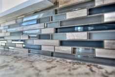 "Who doesn't love the Ebb & Flow EF04 Sand & Surf linear  6"" backsplash with oyster gray grout?! Beautiful blue, grey, and silver tones! https://cbhhomes.com/Homes/98624580"