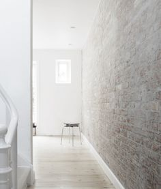 Brick wall in a white home. Design by Norm Architects.