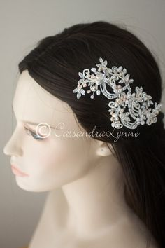 You will love the details in this vintage-inspired wedding hair clip. This lacey design is created with a vine of rhinestone leaves with ivory seed beads windin