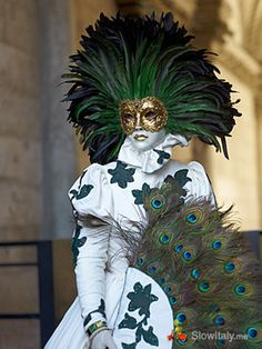 Peacock Themed Venetian Mask~Originally Venetian  masks were made of leather, porcelain or glass and had a practical or symbolic function. Today they are often made of hand-painted gesso or papier-mâché and decorated with feathers and gems.  ~c.c.c~ Google