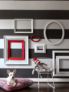 Horizontal stripes give a unique background to a gallery wall.