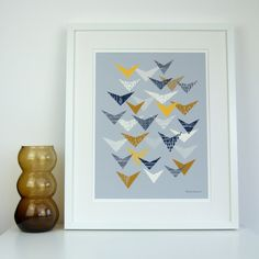 Grey Flock is a new print based on a paper collage I created a few years ago. Its inspired by my love of shape, repetition and colour. Colours used in this piece include yellow, ochre, navy blue, off-white and dark grey on a mid grey background. All my images start life as something hand created, either painted, printed or drawn. My images are then digitally arranged and coloured. The paper size is A3, and measures approximately 11.5 x 16.5 inches. Image size is approximately 11 x 15…