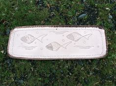 SOLD. Arts & Crafts tray / fish platter in hand-raised heavy gauge copper sheet.  Very Characterful stylised fish in stylised water!  Of unusual, bowed form, the rim loosely punched and hammered. Single later hanging hole.  Unsigned. Early 20th Century. B.G.  6049     £155