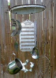 Find different kitchen utensils and gadgets to make a windchime.