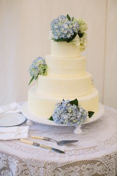 Textured wedding cake with blue hydrangeas