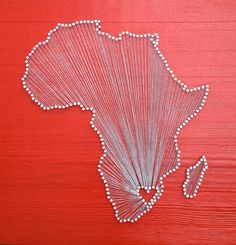 Africa Love // Reclaimed Wood Nail and String Art Tribute to The Plateau Continent. $110.00, via Etsy.