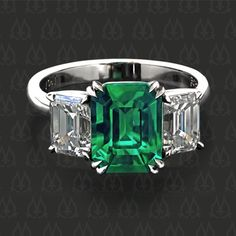 Three-stone ring with an emerald and two emerald cut diamonds by Leon Mege