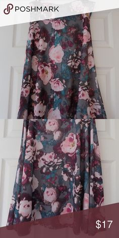 Azure pink/gray floral knee length skirt This gorgeous floral A-line skirt has shades of pinks and teal watercolor flowers on a gray background. Yoga band top, 28 inches from waist to hem. 96% spun polyester, 4% spandex. Machine wash cold, hang dry. LuLaRoe Skirts A-Line or Full