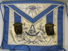 Fantastic mint condition dated 1933 Masonic Lodge master's apron measuring 14 1/2 by 12 1/2. Elaborately hand embroidered.