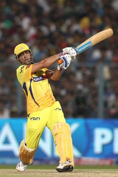 Chennai Super Kings captain MS Dhoni hits over the top for six during the Final of the Pepsi Indian Premier League between The Chennai Superkings and the Mumbai Indians held at the Eden Gardens Stadium in Kolkata on the 26th May 2013. #IPL6