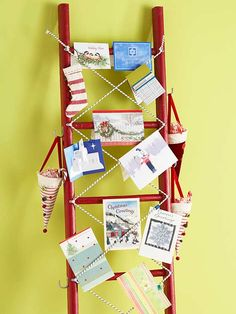 Our favorite Christmas card display ideas blend holiday cards with everyday functionality. Use a brightly painted ladder to display Christmas cards against any wall. Simply tuck the cards over or between bungee cords screwed in place in an X pattern. Add hooks to the sides to hang stockings or candy-filled cones. The best part of this Christmas card display is that after the season is over, you can continue to use it for storage.
