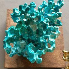 Reclaimed metal sculpture decor. Nautical coral style. Turquoise sea foam color.