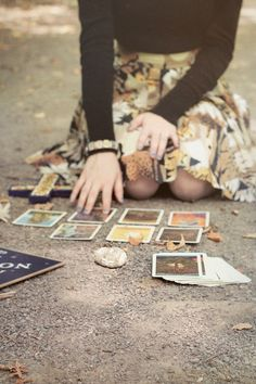 "she kneeled into the dirt, hovering over her cards and frowning fiercely at them like they might move if she thought hard enough.  ""we can't afford to wait.  we need to know now."""