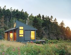 Tiny off-grid cabin on an island off the coast of Maine: solar powered batteries provide electricity, rainwater catchment tank provides water, and there's a composting toilet in the bathroom.