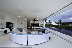 Modern #living room with curved #furniture. More pictures of this house: http://www.worldofarchi.com/2013/05/modern-home-with-sharp-lines-lifts-up.html