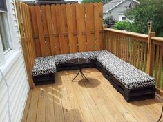 I got this idea from 1001Pallets.com website but put a few of my own tweaks on it to fit my deck. It is made out of 12 pallets, 5 yards of outdoor fabric and outdoor padding. The 4 top wrapped pallets