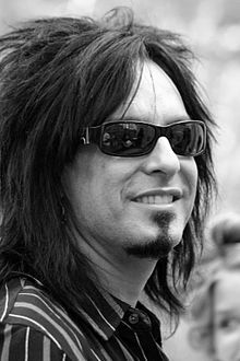 Nikki Sixx (born Frank Carlton Serafino Feranna, Jr.[1][2] on December 11, 1958) is an American musician, songwriter, author, fashion designer, radio host, and photographer, best known as the co-founder, bassist, and lead lyricist of the band Mötley Crüe