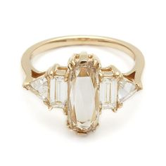 """http://www.refinery29.com/nyc-jeweler-engagement-ring-recommendations#slide-3   """"While I'm never one for picking favorites, I do enjoy making pieces that are one-of-a-kind every time. In some ways, all diamond rings are, just by the nature of the stone. But the Theda is perfectly unique each time, since the center diamond is usually antique or a random Champagne rose cut. Then I choose the other stone to pair with it based on the center, so each is really individually design..."""