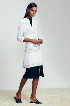 I like the combo of a tunic top over a skirt