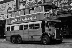 A rather beaten up old LT type bus passes the Empire Arcade in 1948 - note the passenger on the lower deck smiling for the camera! Photo - A B Cross N.B This picture is part of a set looking at the Angel, Islington, travelling from Rosebery Avenue to Islington Green. To see a disappeared world of electric trams, trolleybuses, cinemas, theatres, fashions and architecture, click this link www.flickr.com/photos/warsaw1948/sets/72157638560394736/