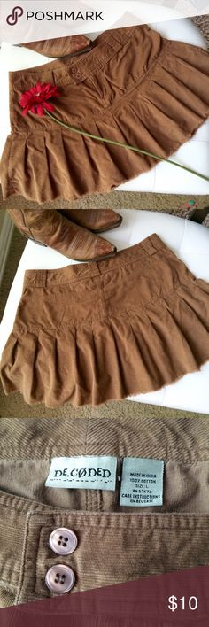"""Super cute mini corduroy pleated skirt Super cute miniskirt with double buttons at tab waist, knife pleats all the way around. Looks amazing with cowboy boots or knee length boots-wear those over the knee socks that go with nothing! Interior had 2 buttons for more support but they were removed because they hurt. Otherwise great condition! Waist measures 34"""", length is 14"""". Color is a warm caramel, most like 1st 2 pics. De Coded Skirts Mini"""