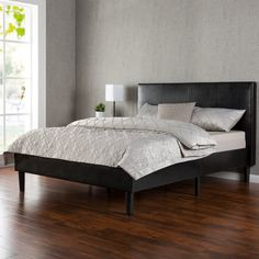 The Deluxe Faux Leather Platform Bed by Zinus will transform your bedroom. It ships in one carton with the frame, legs, and wooden slats conveniently located in the zippered compartment in the back of the headboard for easy assembly. This Deluxe Faux Leather Platform Bed features a headboard and low profile footboard style frame, with wood slats and exposed feet for support. Espresso colored faux leather for a luxurious look that makes an excellent addition to any bedroom.