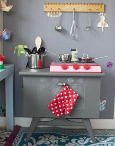 Play kitchens... So cute.  I think a lot of dads could actually make this themselves.