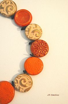 https://flic.kr/p/AUQGyg | polymer clay fall necklace | stamped with different jewelry pieces and buttons