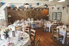 Vintage wedding decor with a gorgeous exposed brick wall and pretty polka dot bunting