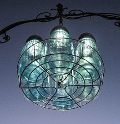 Mason Jar Solar Chandelier - made with a canner rack, mason jars and lights ... so cool ... why didn't I think of that?