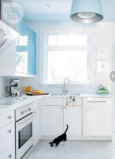 white kitchen blue walls